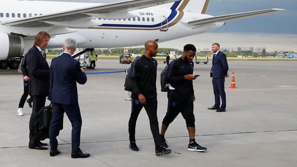 Putin's government presents England players with gifts of tea as they touch down in Russia