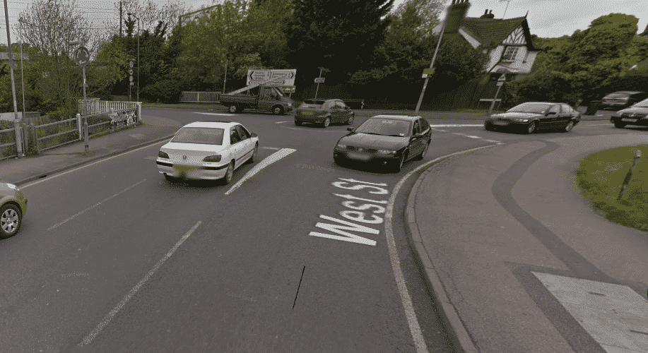 TRAFFIC CHAOS as three cars arrive at mini-roundabout at the same time